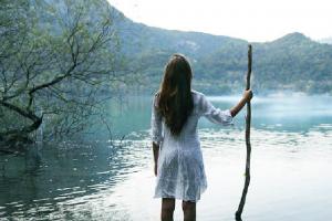 girl at lake doing spiritual coaching