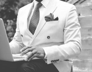 Man in suit at laptop