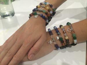 lady wearing chakra bracelets